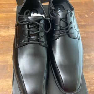Brand new men's dress shoes.